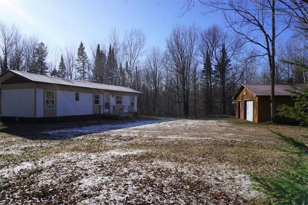 Just the place for hunters, ATVers and nature lovers! Well maintained manufactured home with bunkhouse addition, detached garage, newly improved driveway and newer holding tank on 31.65 acres of some of the best hunting around!  Direct access to Tuscobia Trail and close to national forest with acres of additional hunting land; near Dead Horse Trail for endless hours of ATV riding.  Surveyed with corners marked.  Seller will include nearly all furnishings.