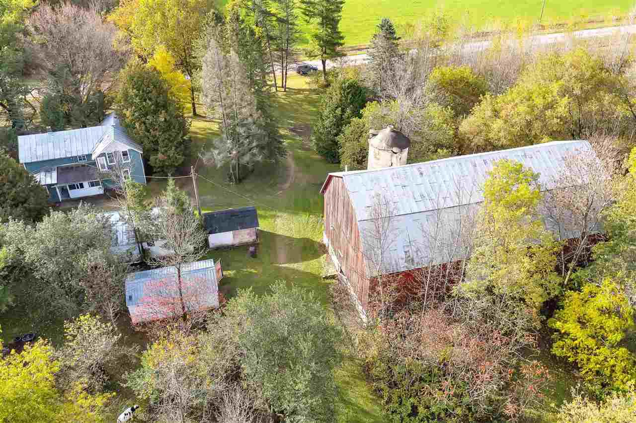 11.5 wooded acres w/barn + outbldgs, creek & more.  Amazing Hunting right out your door.   4 bdrm, 2 full bath home, with 1st floor laundry & large back porch.  Older farmhouse with several additions, needs work, but much demo work is already done. 10+ Apple trees.  Livestock allowed so this property makes the perfect Hobby Farm and Horses are also allowed.   Snow mobile trails on back side of property and Machickanee Forest & flowage very nearby for hunting/boating/outdoor activity, zoned RR. Wildlife abounds as the setting is very private/secluded yet 25 minute drive to Green Bay.  No FHA