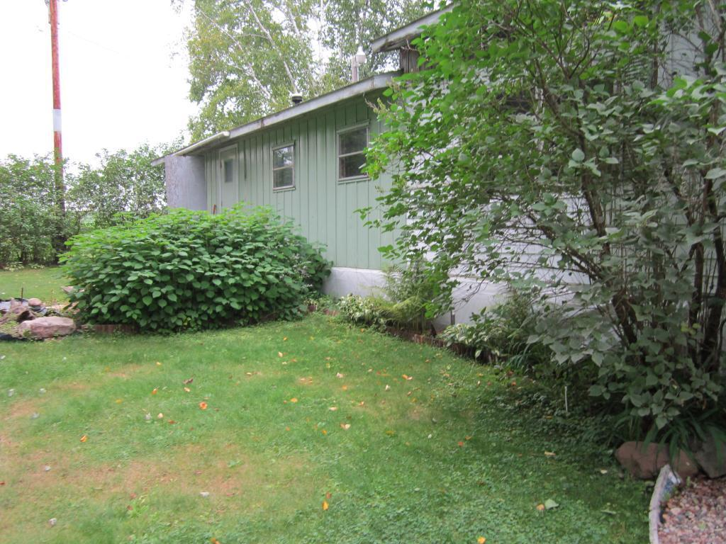 Looking for a fixer-upper at the right price on a beautiful lot? This 12x60 Manor House Marshfield Trailer on a back lot on Balsam Lake might be for you.  Beautiful lot with old Pine Trees and landscaped yard. Great little neighborhood for walks in the country.