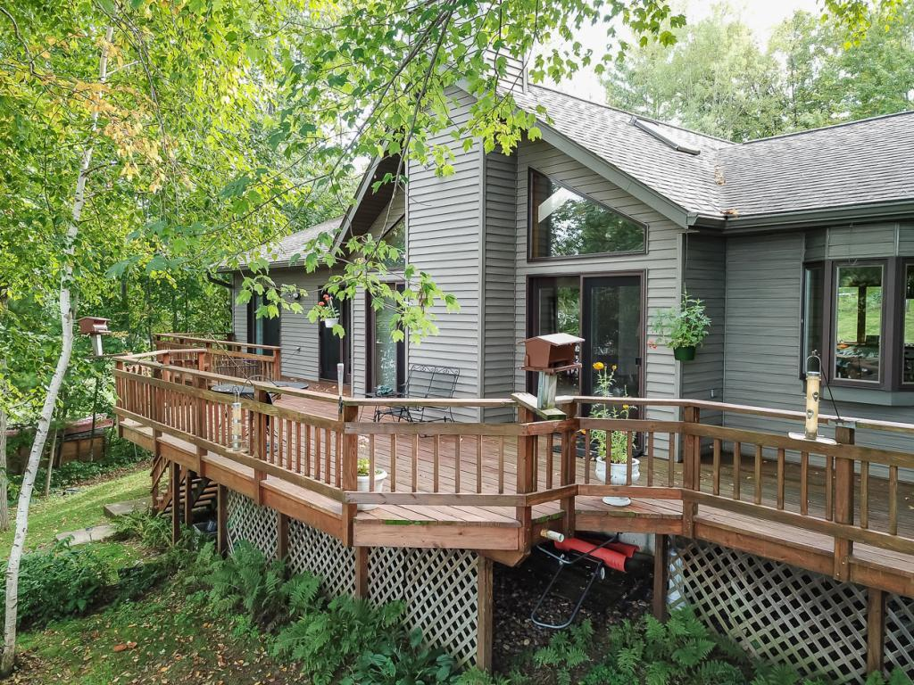 """This is the perfect building for a cabin or a year round home. The lot and elevation to the lake are perfect. The views up the length of the Apple River Flowage are beautiful. The seller's custom design and building ideas are seen throughout the one level living concept. The open space with the great room taking in the living area, the dining area and the kitchen are awesome. There are two main floor bedrooms and a non-conforming 3rd bedroom in the basement. The beach area is a quick drop to the main river channel and offers great  """"off-the-dock"""" swimming. The seller has caught lots of fish off the dock and has now retired from the sport."""