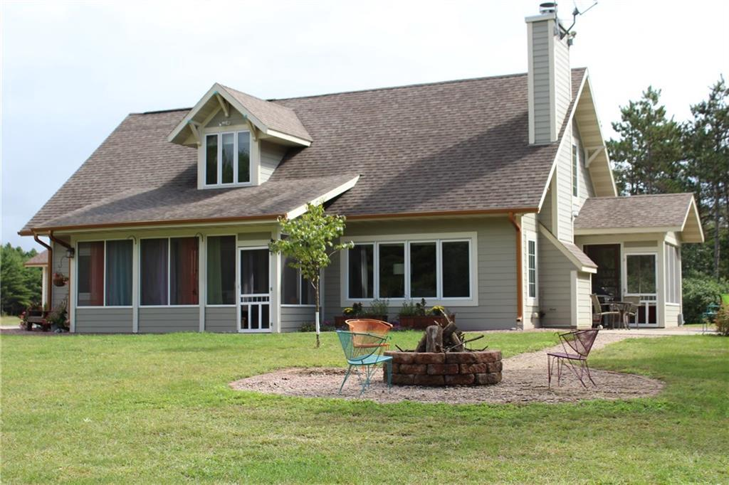 """VERY well cared for home on 40 acres w/almost brand new(52x32) 3+ car garage~finished/insulated w/a BONUS(28x11)""""hide-out""""w/heat & AC!PLUS~40x30 Pole shed-finished w/electric,1 horse shelter incld+dog kennel.Nice set up for a few animals!Rindahl Creek~Class 1 Trout Stream,POND,woods,trails,open land,pretty yard,fire pit & an EXTRAordinary home w/cathedral ceiling,fire pl,loft bdr w/sitting rm/office &lots of storage.1st fl laundry.TWO 3-season rms.NEW flooring: LR,Kitchen & bdr.  33A MFL closed."""