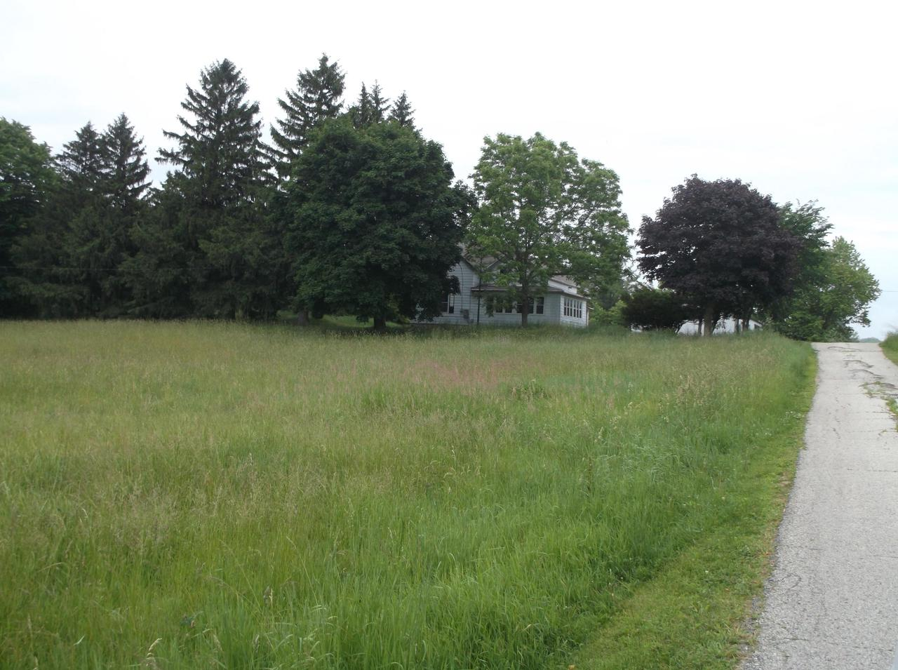 Rural farm house with 30x54 metal pole shed. House needs work to make it a home again. Basement has outdoor access. The setting is great witha west front window view, and a large grass field in front so you can watch the sunsets. This is a Fannie Mae HomePath property. Sq approx