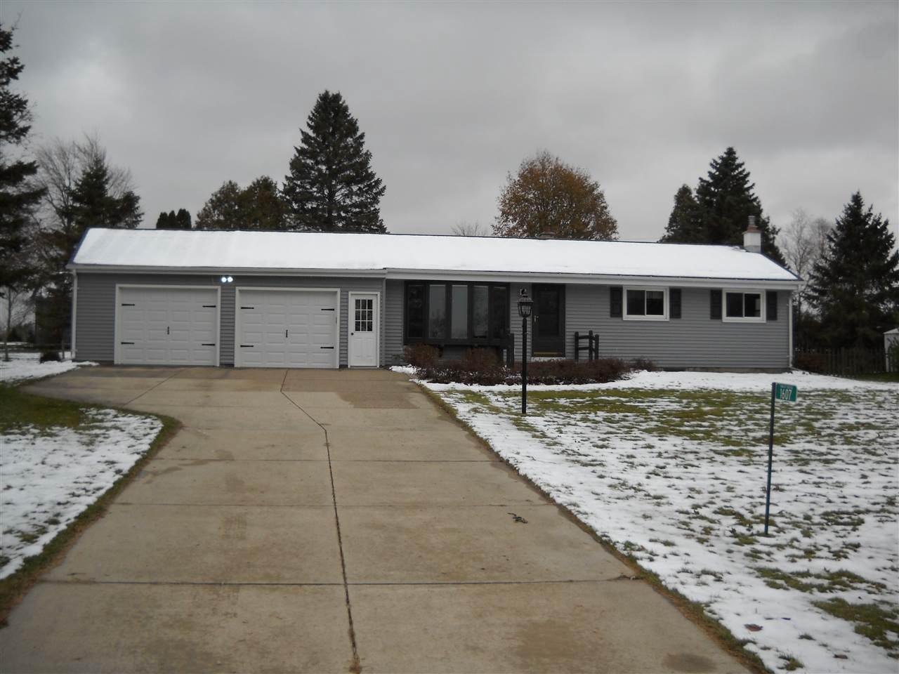 Country Ranch at it finest. This Home features 3 bedrooms, 1.5 baths, a spacious living room, and a finished lower level with a bar and fireplace. The exterior includes a newer roof, siding as well as fresh landscaping. Grill out on the patio overlooking the wonderful yard.