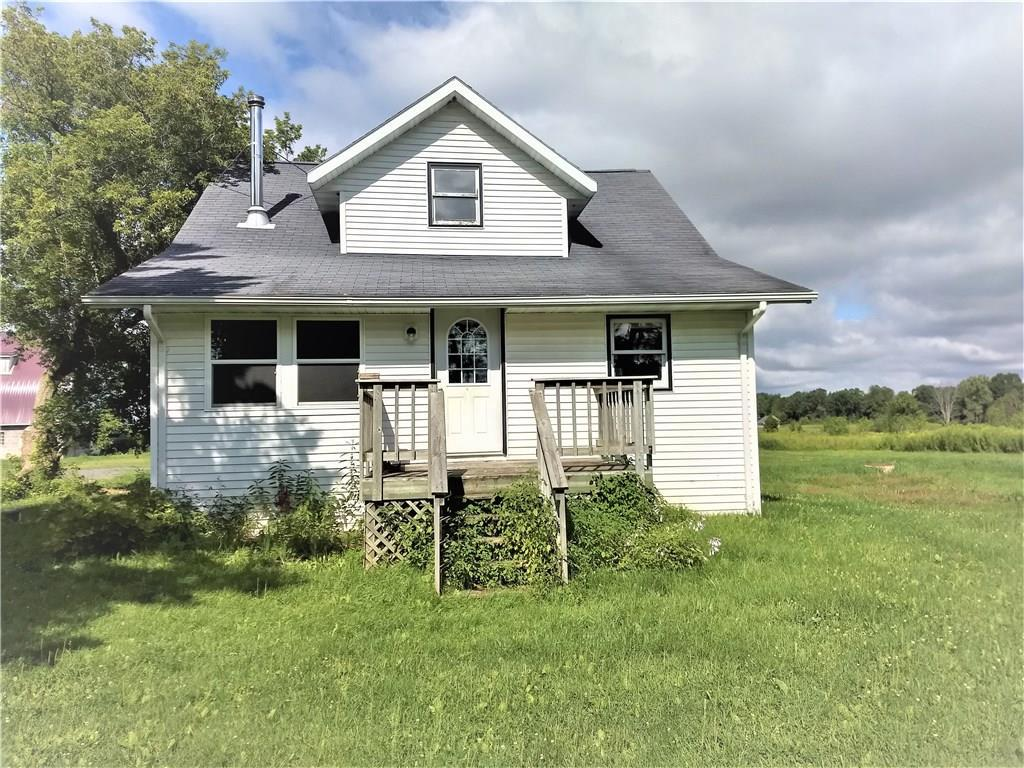 Perfect Hobby Farm, 35.5 acres, yard with fruit trees, 3 Bedroom home with possible room for expansion on upper level possible 4th bedroom, nice sized master on main floor with huge walk-in closet/office space,  lots of closet space on upper level, newer gas forced air furnace, and main floor flooring in kitchen, dining and entrance area, just completed professionally painted 58x34 Barn w/newer Metal roof, 32X16 Building set up for Chickens, roughly 18.3 acres tillable and rented for $1098 per year which almost pays the taxes and 17.2 wooded, perfect combination of woods and tillable for hunting and growing crops, raising cattle, pick your own apples or relax in this terrific country setting.