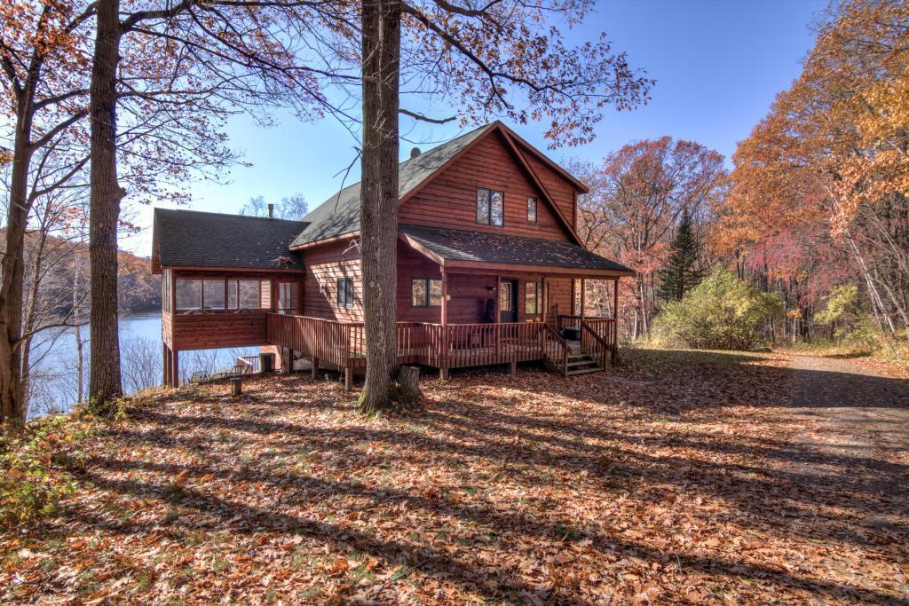 This secluded estate offers it all from its own private lake to the custom built chalet offering 4 BR and 3 full baths.  Home features granite counters, hickory cabinets, large great room with gas log fireplace, large lakeside deck and lakeside screened porch, lower level walkout rec. room, and Morton building for the toys.  All this and more on 171 acres.