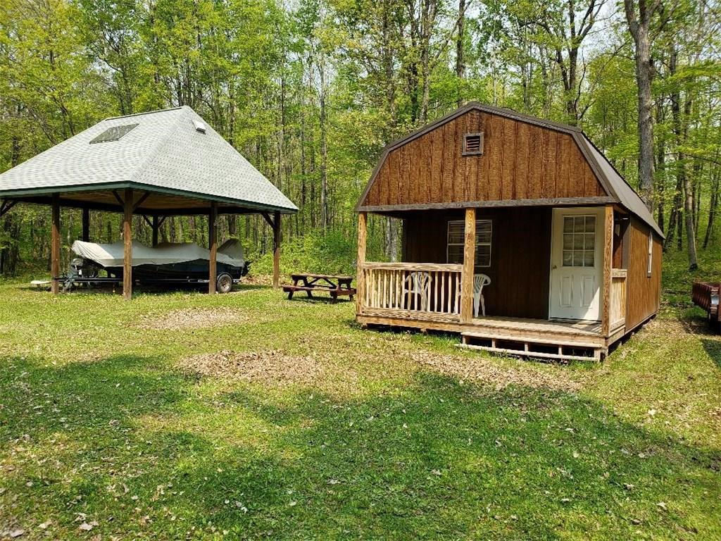 Private and off the grid! The furnished cabin is powered by a generator and the  24'x24' Pavilion with loft is solar powered. There is an outdoor shower and a cemented vaulted privy for your convenience.  All of this is waiting for you  among  the  5 acres of mature hardwoods.