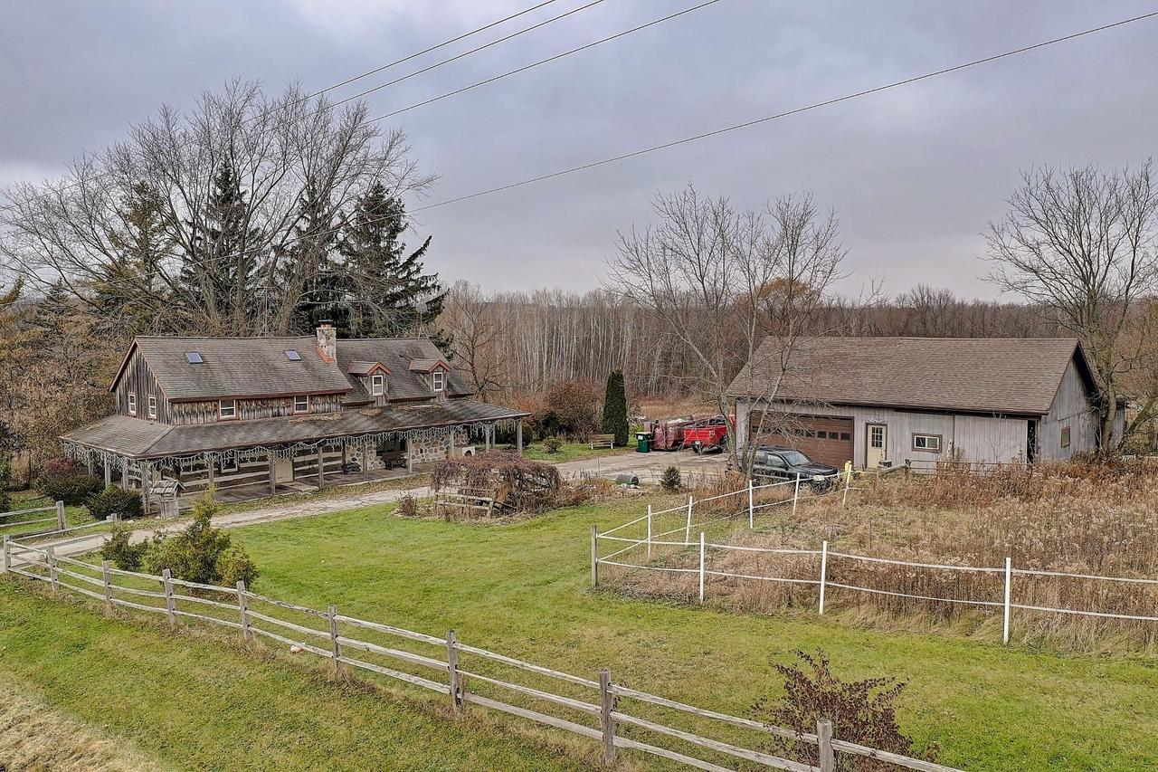 $305,000.  Home for the holidays!  Spectacular display of yesteryear's craftsmanship in this 1840's hand-hewn log home on 8.97 Acres in the Township of Farmington.  Like a scene from Little House on the Prairie, this spectacular countryside setting offers a picturesque Americana lifestyle for the gentlemen's farmer!  Beautiful hardwoods ordain the interior spaces with a charming warmth including hardwood floors, exposed ceiling beams, tongue and groove Pine and original chinking between spectacular logs.  Spacious KIT includes appliances!  Lofted Master features WIC & BA. 2 Addl BDRMS upstairs feature skylights for added light.  Awesome stand alone wood burning stove creates character & warmth in the coziest home you will ever step foot in! Fantastic 4 Car DET Gar + Barn with stalls.