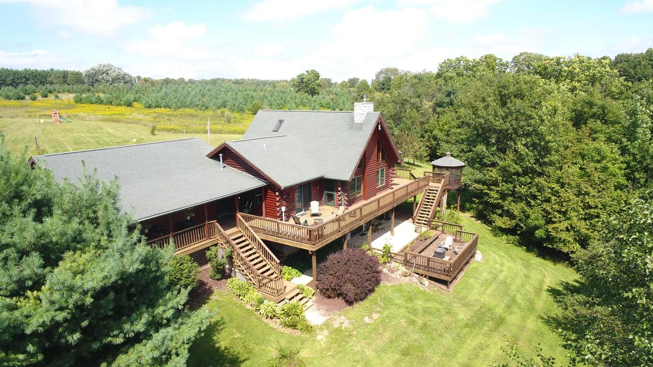 OPEN HOUSE! - Saturday, December 7 2019, 1:00 p.m. to 3:00 p.m. - - Perched on a ridge in SW WI's rolling Driftless Area sits this upscale log home together w/ a 60x40 barn/outbuilding, which is a gem in its own right. Stunning views of woods, beautifully landscaped yard, & miles of farmland. Deer hunter's paradise!! Home features vaulted ceiling, skylights, kitchen soapstone counter tops & wooded cabinetry, large loft, sun rm, office & gas stove fireplace on each level. Entertain guests-1,000+ sq ft deck w/ screened-in gazebo & fire pit. Attached oversized 30x28, heated garage lends itself to a workshop.  Expansive lawn, w/ Amish-built playhouse, for playing & gardening, apple trees throughout.  Woods for hunting, hiking, birding & exploring. 41 acres in MFL reduces taxes!