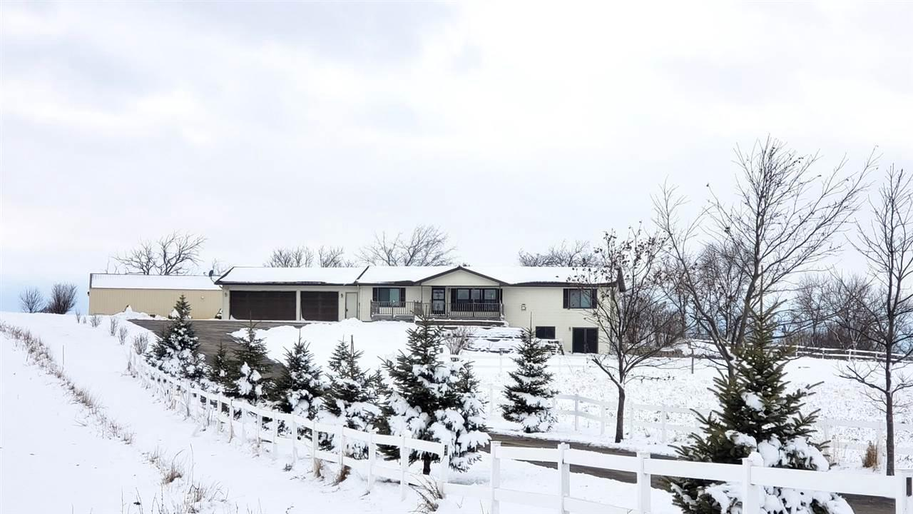 SET OFF THE ROAD is this walkout ranch w/5+ acres (35 acres avail) just over the Sheboygan County line, just short drive to Kiel. Built in 2002, this one-owner hm needs a new owner! Perfect for a hobby farm, horses or just enjoy the country. Sprawling ranch w/over 2400SF, master ste w/dbl sinks, living room w/vaulted ceiling & FP, BIG kitchen w/endless counters & cabinets, SUNROOM w/pine ceilings & walls, 1st-flr laundry, LL is walkout w/3 extra rms that could be guest rooms, office or storage. 30x64 detached pole bldg. 30x40 of it is a heated workshop. A 24x30 separate area was for horses.