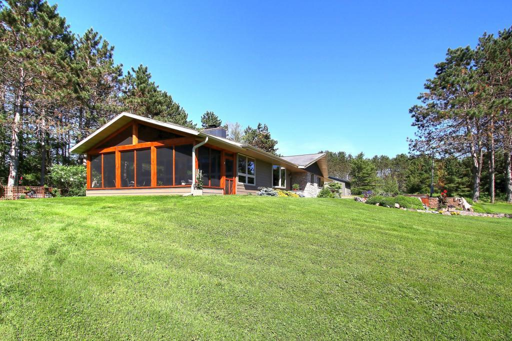 Stunning Chippewa River home with over 34 acres of pure Wisconsin! This home has been completely renovated with high quality touches. Amazing three season porch with panoramic views of the river, stacked stone fireplace in the living room, maple kitchen cabinets, cambria quartz counter tops, maple and tile flooring, fully finished lower level, 30x30 storage barn, beautiful gardens, level elevation and sandy shoreline. Relax in the hot tub, fish, swim, kayak, hunt, this home has it all.