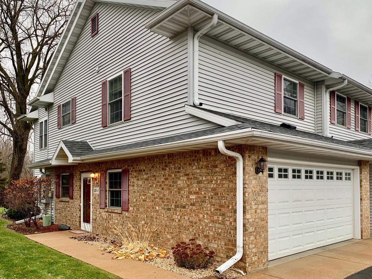 Rare FIRST FLOOR Slinger condo. Better-than-new, townhouse style, completely remodeled in 2018! NEW bright white trim, 3 panel doors, laminate floors, carpet, granite countertops, under mount sinks, and faucets. Eat-in kitchen has loads of cabinets and convenient pantry closet. Living room has corner gas fireplace with stone surround. You'll finally get that sunny corner office you've always deserved! Take your breaks on the concrete patio and enjoy the greenspace. Private master suite upstairs with dual closets and shower stall. Second bedroom also features 2 large closets. No more cold feet: IN-FLOOR HEAT extends to 2-car garage, which also has spigot and floor drain. In-unit laundry and utility sink. Walk to downtown, Slinger schools, park, and skiing. A minute to Hwy 41. MUST SEE!