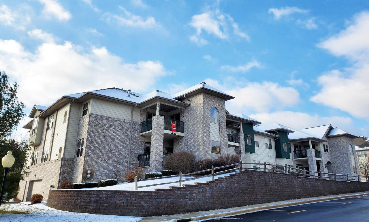 One of the most sought after condominium complexes in West Bend.  This first floor unit has an open concept, 2 bedrooms and 2 full bathrooms, a gas fireplace, 2 heated underground parking spaces, a front cement patio area and one of the largest basement storage lockers.  Property is vacant perfect for if you are looking for a quick close. Schedule an appointment today so you don't miss out on this one.  The location is a huge plus making it an easy walking distance to parks, restaurants and shops. Pets are allowed with some limitations.