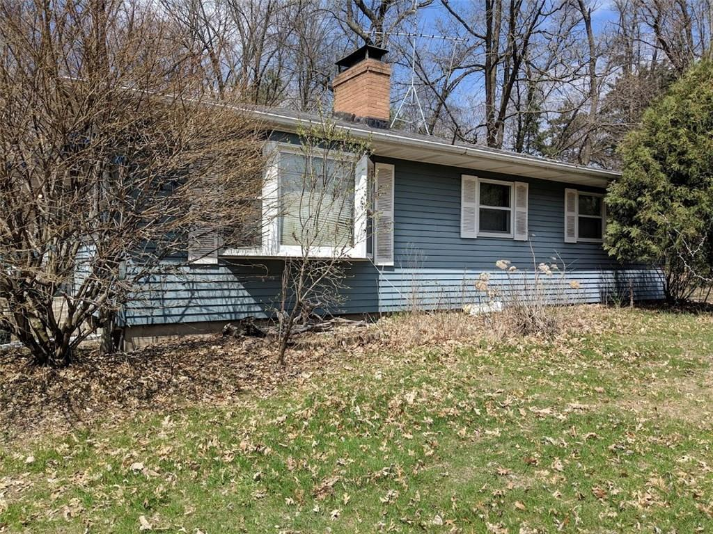 3 Bedroom Home with Great Location and Views of the Apple River. Large 2 Acre Wooded Lot. Home needs some TLC  but has solid bones. Great Investment Property or Flip House.