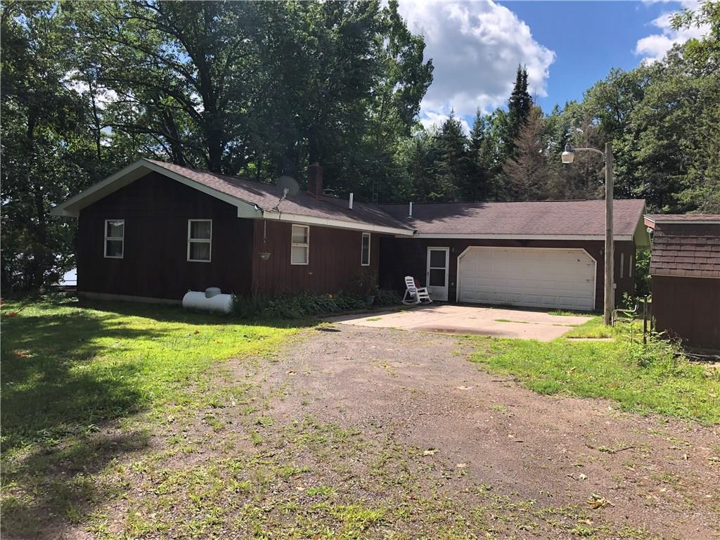 Rare find. 200?+ of sand shoreline on sought after Whitefish Lake. This classic ranch style home is solid from the ground up. Featuring 3 bedrooms, 2 full baths and an open kitchen/living room. 2 car attached garage and large pole building with heated shop give you ample storage. A great property for a great price.