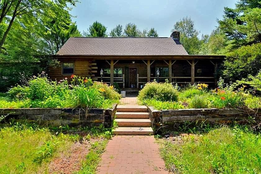 Amazing investment property! This approx 15.5-acre horse ranch is an equestrian paradise! Property includes a 5-bedroom/3-bath log home w/stone fireplace and walk-out basement. Outbuildings include a large heated stable w/11 pens and bath, stable w/2 pens, and (2) 4-car garages. Man-made pond. House needs major updating but stables are ready for business! Great location near Green Bay!