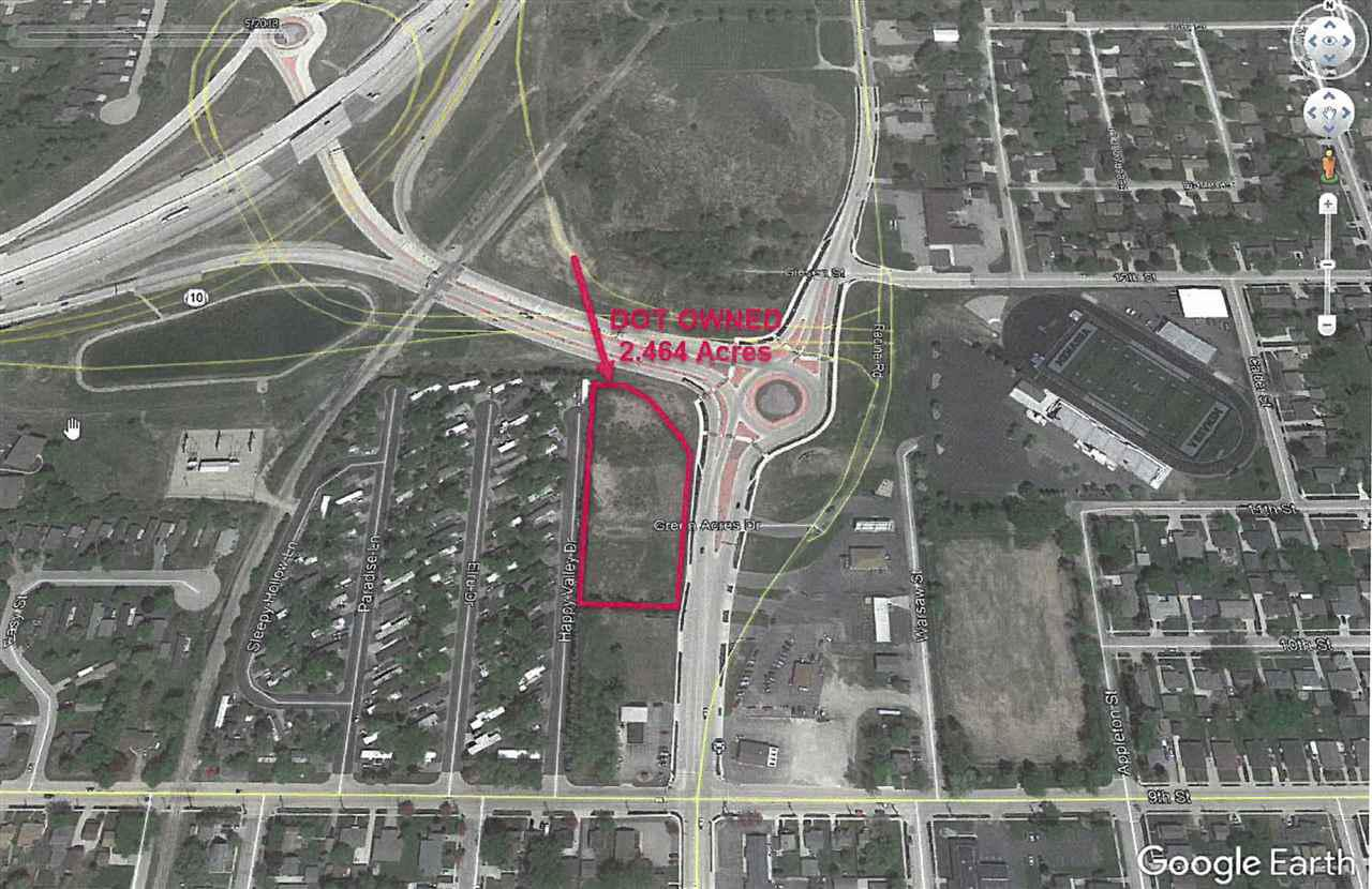 Remarkable commercial 2.46 acres of land excellent visibility located adjacent to Hwy 441/10 roundabout. This property consists of 3 parcels which are partially located in the City of Menasha and Village of Fox Crossing. Prime commercial property.  Zoned: Commercial.  No Land Disclosure form available.