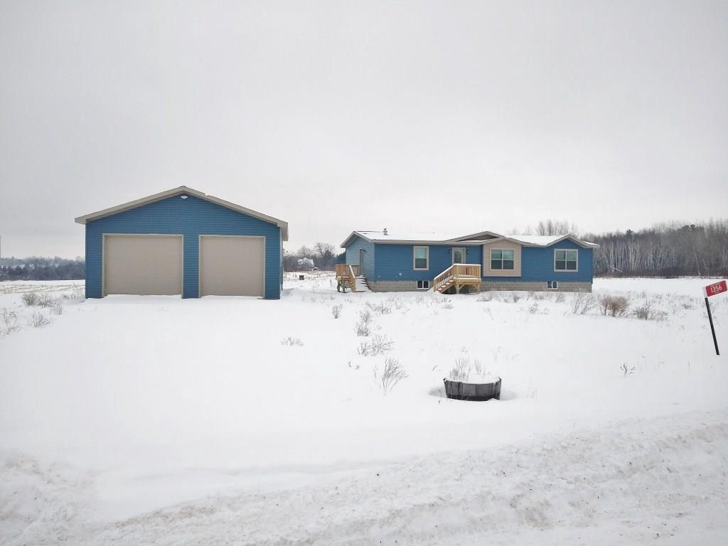 "New 3Bd, 2Ba manufactured home w/slightly vaulted ceilings giving you that spacious feel, this home sits on a cement slab w/crawl space and comes w/forced air heat, A/C, & a new mound system. There is also a 30'x40' garage w/12' side walls & a 6"" thick poured concrete slab. Seller will black dirt & seed the yard at sellers expense in the spring along with pouring a concrete apron in front of the garage. Adjacent 1 acre lot can be bought for an additional 20K."