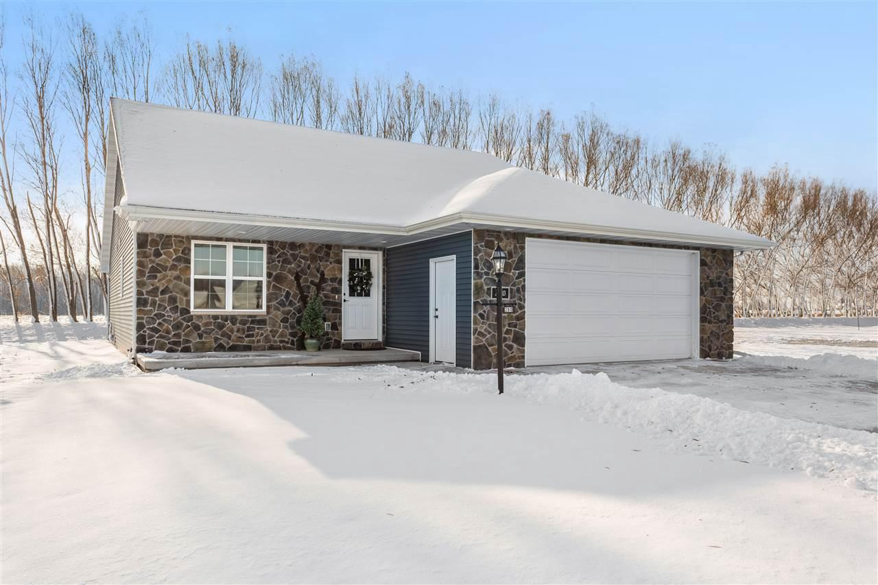 Centrally located between Appleton and Green Bay within walking distance of Royal St. Pat's Golf Course. This newly built home is sure to please. Open concept complete w/ display kitchen. Lg marble island w/ range top. Walk in pantry. Appliances included. LVP flooring. Dining, living room & kitchen all flow together to create a great space to entertain. Pellet stove insert in living area will eliminate your heating bills. Patio door leads to backyard patio. First floor laundry. Master suite has walk in closet & full bath. Lower level is ready for all your finishing touches!