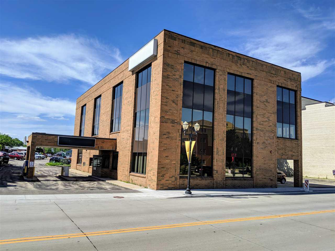 This all brick 3-story building in growing downtown Menasha provides space suitable for many types of business - restaurant, bakery, banking, office, retail, service, etc. Located near One Menasha Center and overlooking Menasha Marina offering excellent views. This highly visible property with a drive-thru is conveniently located with easy access to Highway 441. Spaces for lease: 1.)Suite 100(prior bank with drive-thru): 2,300sf, 2.)Suite 103: 380sf, 3.)Suite 301: 1,075sf, 4.)Suite 302: 867sf