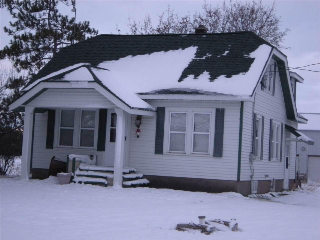 Hard to find! Country property only 5 miles from Clintonville. Two bedrooms on main level, one up. Original woodwork and hardwood floors. Nice outbuildings. 32x64 garage and shed. 60x80' shed/corn crib. Small barn, grain bin. New well being installed. Perfect hobby farm for beef, pigs, horses, etc. Year built is estimated.
