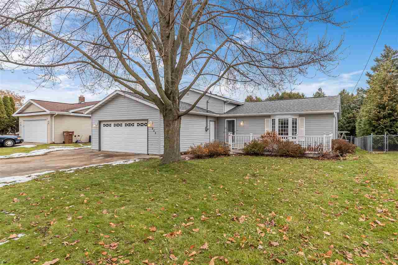 3-bedroom home w/ attached 2-car garage near schools & highway access! Features include eat-in kitchen w/ patio doors, sunny living room w/ bay window, fenced-in yard complete w/ deck & storage shed, & walk-out LL w/ full-sized windows & access to the garage! Updates include shingles, siding, garage door & opener, furnace & A/C, water heater, carpet, & more!