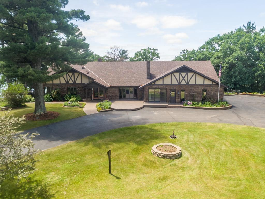 First time being offered for sale!  310 Ft on Lake Wapogasset, 7400 sq ft Rambler, 7BR, 4.5 baths and the lower level is finished for a 2nd family. Lake Wapo-Bear Trap association for sewer and property is served by a private well. Features include New roof in 2018, 3 fireplaces.  Home has 2 furnaces and 2 A/C units each serving half of the home, both were new 8 years ago. You cant imagine how beautiful this property is, so come out and see for yourself! The family took pride and care for this home since it was built, but now the seller is ready to pass this along to another owner to call home.