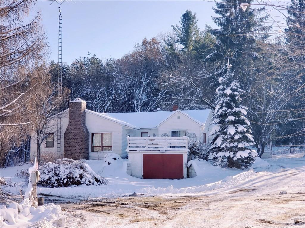 13.94 Acre Hobby Farm!!! 3 Bedroom, 2 bath home with attached garage 30x60 barn with high ceiling, 26x27 garage/shop with concrete floor, 32x56 pole shed with overhead doors, yearly cropland income, wooded acres for hunting. Cased well 2010, mound septic pump replaced 2019. Log addition built in 2001. Peaceful setting with abundant wildlife.