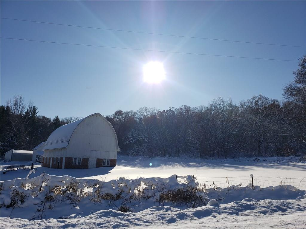 13.94 Acre Hobby Farm!!! 3 Bedroom, 2 bath home with attached garage 30x60 barn with high ceiling, 26x27 garage/shop with concrete floor, 32x56 pole shed with overhead doors, yearly cropland income, wooded acres for hunting. Cased well 2010, mound septic pump replaced 2019. Log addition built in 2001. Peaceful setting with abundant wildlife. Co-listed with Jessa Peterson 715-864-1726