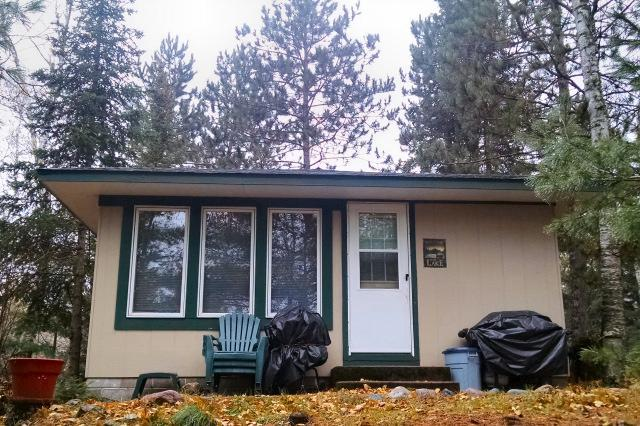 Lost Land Lake - On the SW shore of scenic Lost Land Lake sits this darling 2 BR, 1 BA condo/cabin. Updated and well maintained. Newer appliances, water heater, dock, roof, new furnace in 2017 and more. Private dock and fish cleaning house. Extra storage in garage. Just come and enjoy, move in ready!