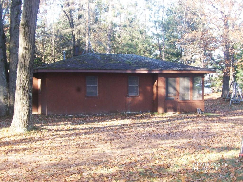 It's all about the location! Fabulous low bank lot.  Current cabin is useable - just needs updating. The 2 car garage is in great shape. Spacious screened porch faces the Lake - The lot is the best!