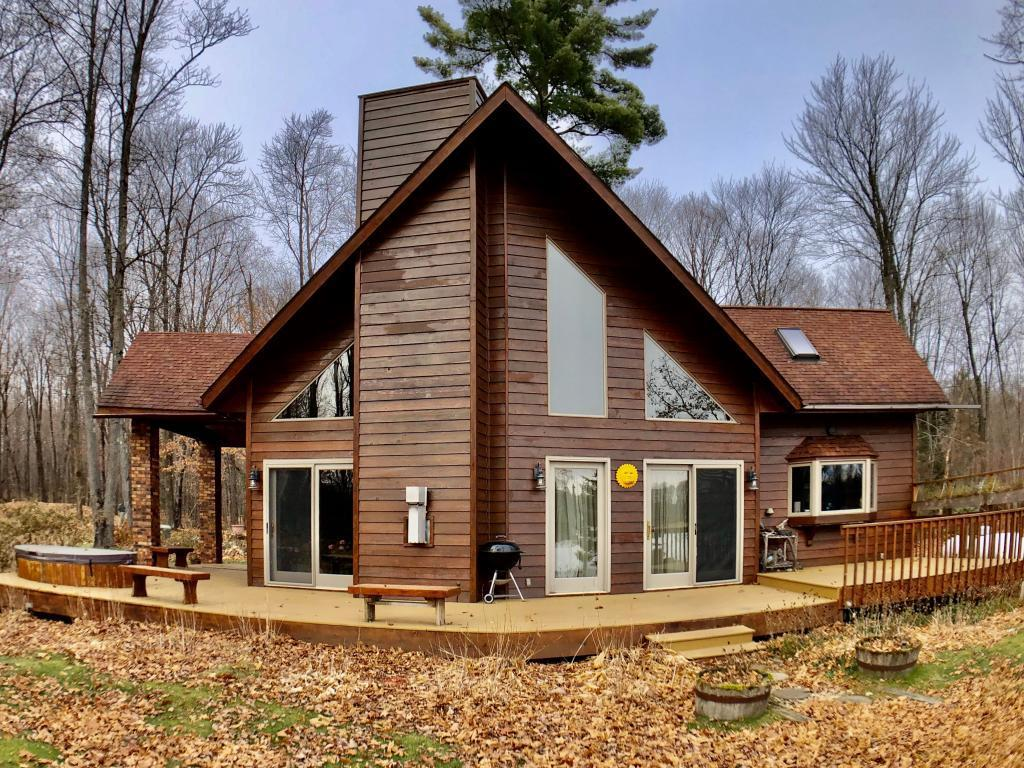 Gorgeous 2 story cedar sided, 3 bedroom, 2 bath chalet on 32 ft of level lakeshore.  Living room, dining area and a dream kitchen are open concept with a bedroom, bath and sitting room loft area.    Excellent open water views.  Lot can be divided and suitable for another dwelling.