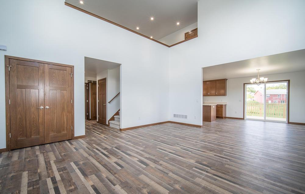 *New Construction - Every Thing You Could Ask for in this HIGH QUALITY, Custom Built, Open Concept Home! *BASEMENT ACCESS GARAGE STEPS, 8FT Overhead Garage Doors w/10ft Ceilings & wifi compatible edo! LED lighting throughout! Lifetime Warranty on windows! Soffit Outlets w/Interior Switch! 18' Cathedral Ceilings w/ Loft overlooking great room. Quartz Countertops,  Gas Fireplace w/ remote rontrol. Main floor laundry w/ cabinets & countertop, trendy bathroom Barn Door,  Dual sinks in master bath. Extra hooks & cubbies for utilization of space, Everywhere! 3 panel doors, elegant skip trowel plaster finish, walk-in closets & pantry w/ Wood shelves! Radon Mitigation, exterior clad door jams, Spray foam end caps. Concrete Driveway & Deck. NOW READY TO MOVE IN!!
