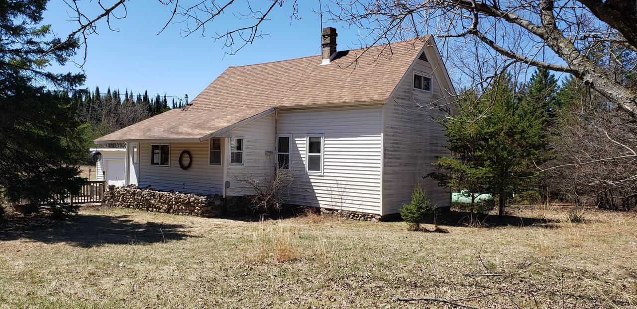 Great location for this farmhouse style home with 10.71 acres of land. The three-bedroom 1.5 story home has 1,204 sf. An attached one-car garage, plus a large barn with three garage doors provide lots of storage for all the toys. This home has had several updates, including a new roof seven years ago, some flooring, ceramic tile, new furnace in 2014, and vinyl siding. Propane heat with electric backup. The upstairs has two tandem bedrooms with lots of storage. Spacious rooms offer sleeping room for many. Includes canvas storage unit.  Close to Crivitz. Easy access to the snowmobile trail.