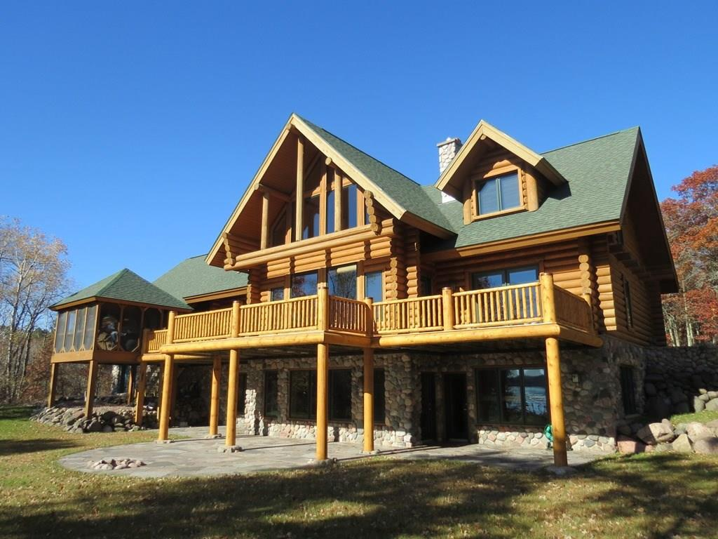 Outstanding log home on Gilmore Lake. Exceptional parcel with 6.92 acres, 400+' of lakeshore and level elevation. Spacious & convenient floor plan is attractively finished inside and out! Massive wood burning fireplace, along with two gas fireplaces. Sauna, hot tub and wet bar in lower level. Large sundeck overlooking the lake with screened in porch. A truly special property on this high quality lake west of Minong.