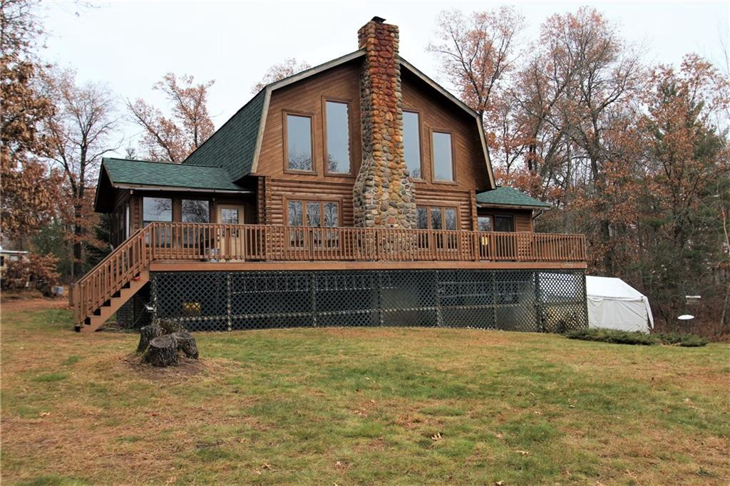 Enjoy beautiful sunsets & peaceful surroundings sitting on the deck of this 3 bedroom log home with 3.5 acres of land & 350 ft of low elevation frontage! Master bedroom and laundry room are on the main level for convenience, plus 2 bedrooms, 1 bath in the loft. The large lower level can be finished for a bedroom, family room, etc., plus it's plumbed for a 3rd bathroom, and hold plenty of light with the walkout. Add your dream garage or pole barn to complete the package!