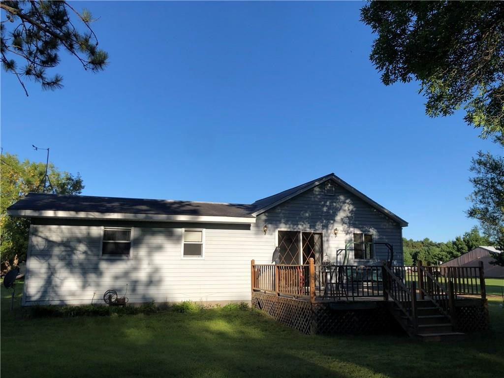 This three bedroom charmer has over an acre, a huge garage with workshop and is in the middle of Lake Holcombe, ATV/Hunting and snowmobile territory! An outdoorsman's dream cabin or a wonderful starter home or investment property. Mature apple tree, less than a 1/2 mile from lake, and ATV/Snowmobile trails. Plenty of public land for hunting. LP tank comes with the property, as does huge deck.