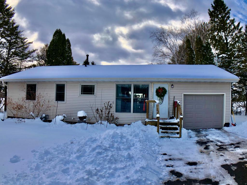 Enjoy in town lake living with this updated  2 bedroom 1 bath home. Beautiful level elevation with trees, and sandy hard bottom frontage. Home has hardwood floors throughout, a gourmet kitchen, living room features fireplace and large lake views. Full basement, large deck and a 1- car heated garage.