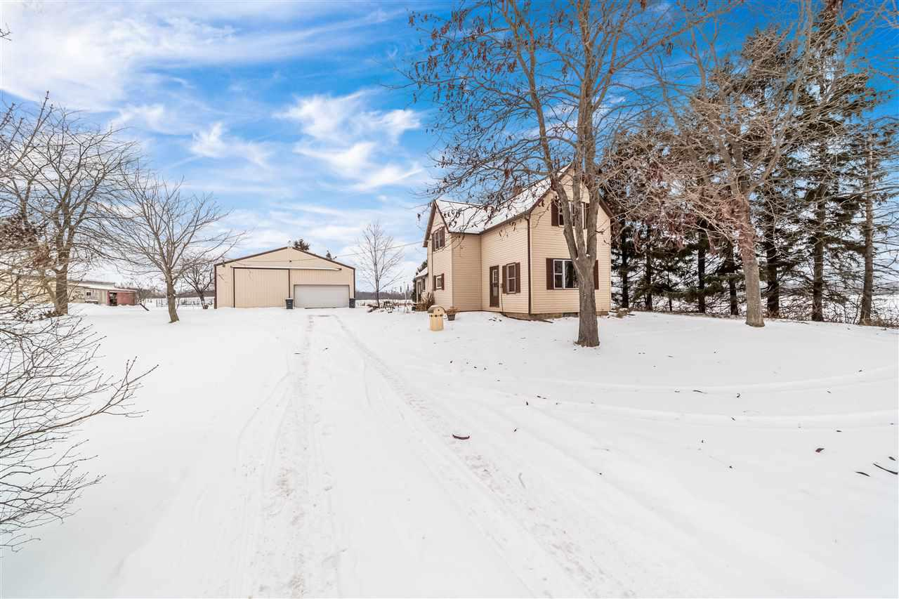 """Updated farmhouse with 10+ acres & 60'x42' pole shed! This home features an open concept kitchen w/ convenient roll-out cabinet shelving, well-lit front living room, as well as an exposed staircase to 2nd floor loft, 1/2 bath, & bedrooms. Renovations include kitchen, dining room, living room, bathrooms, & loft. Additional updates include: windows throughout,  new 290' well, septic system, roof, all appliances, sump pump, water softener, furnace, A/C, & more! Property also includes 2 horse sheds & organic fruit trees. Parcel zoning will change w/ purchase. Property being sold """"as is."""""""