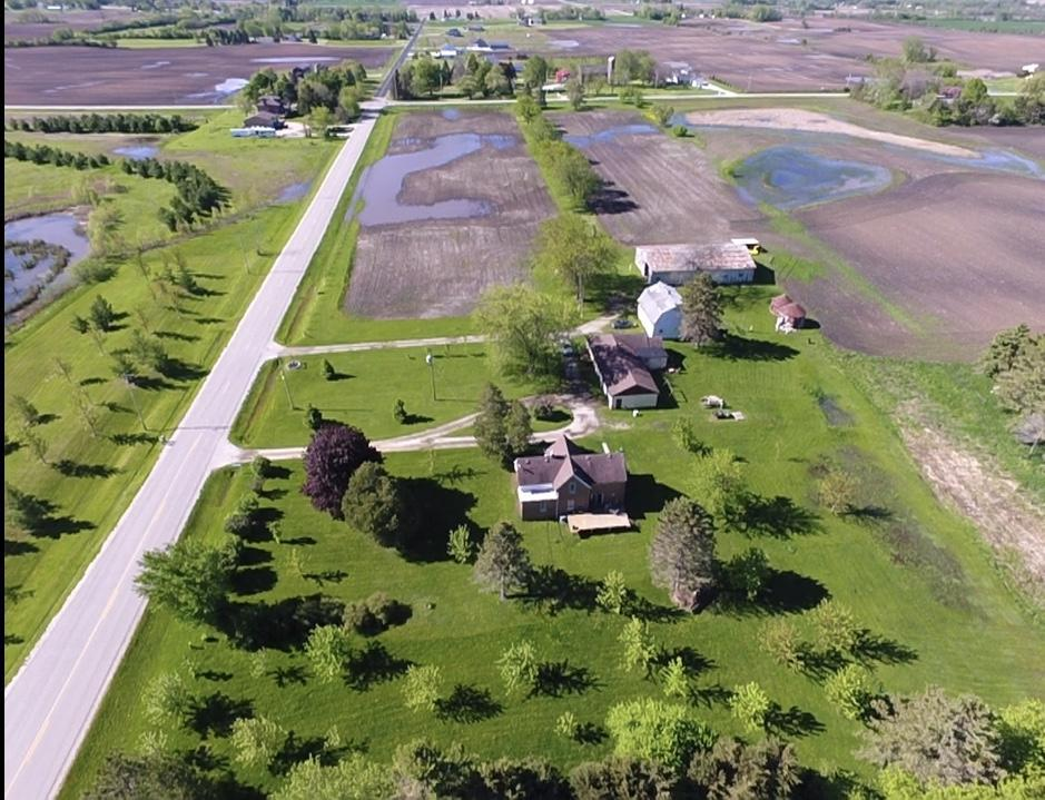 What an opportunity!  37.7 acres zoned agriculture at this time.  Raise your animals and use current barns or build more.  60 x 80 barn with water & electricity.  Farm house has 4 bedrooms and a basement.  Building with 3 car garage also has a rented 1 bedroom apartment. New furnace and a/c put in 2017.  Or talk to Yorkville about developing the land.  Great school district with plenty of opportunities.  Close to the interstate.
