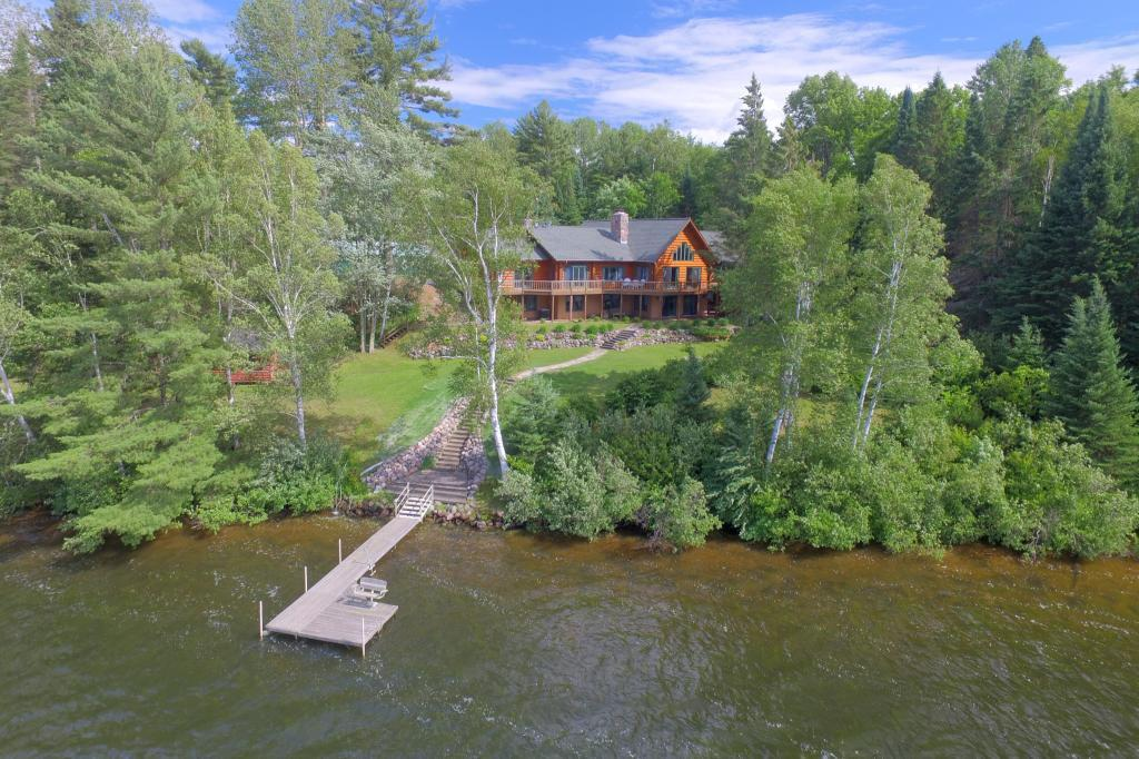 Magnificent Long Lake Estate with 1 wooded acres for the ultimate in privacy!  This grand log home features include:  stone fireplace, log beams in the living room, spacious kitchen with additional prep/pantry, master bedroom suite with sauna and fireplace.