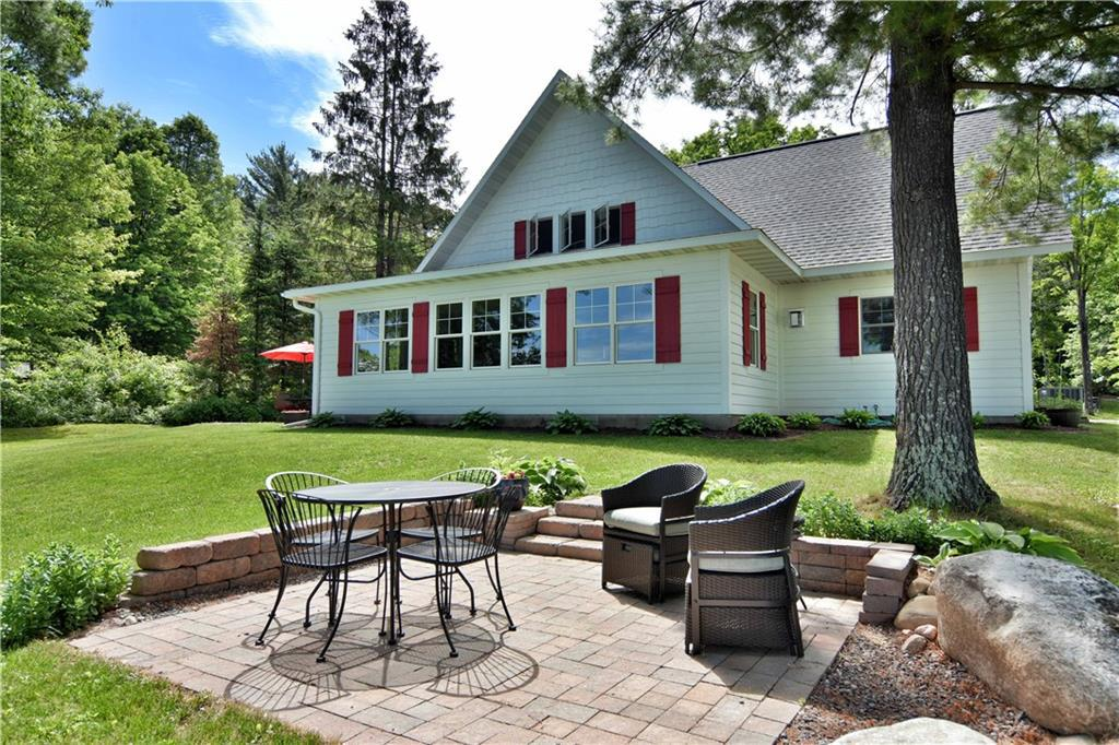 This stunning home on the mighty Chippewa Flowage, 3 bedrooms, 2 full baths, soaking tub in master bathroom with walk in shower, built in 2014 this home offers all the modern comforts with open concept kitchen/dinning and living room, large stone fireplace in main room with wall of windows over looking the lake, low elevation offers ease of access to lake, sand beach, beautiful landscaping, oversized 3 car garage, with over 3 acres of land. Make this your next get away!