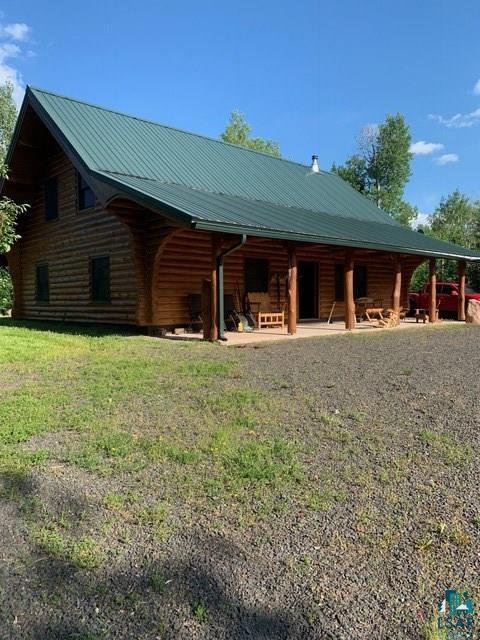 CUSTOM LOG HOME W/140 acres. 2 bdrms down and full loft that sleeps 8+. All log beds stay. Open living room, kitchen, dining and foyer. Full bath w/laundry. In-floor heat. Full length covered log porch. This is an absolute sportsman's dream with 36x54 metal pole barn, 2 ponds, 6 miles of groomed trails, 12 deer stands, 4 food plots and much of the equipment to maintain the trails and food plots will stay. Many a trophy deer have been harvested off this property. Most of land is in MFL with low taxes.  Located 12 miles from Iron River and only 3.5 miles from Port Wing, Lake Superior and the marina.