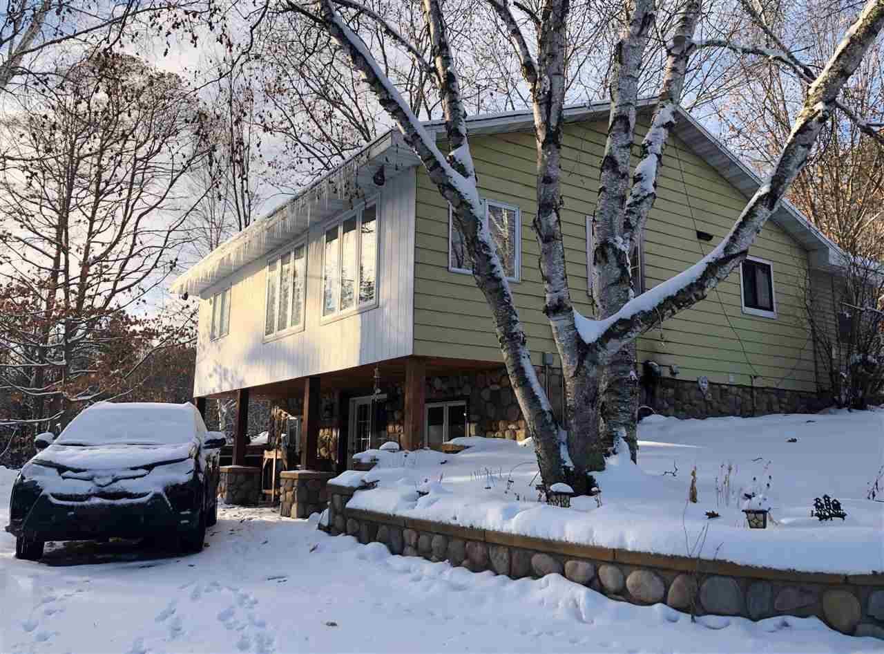 Perfectly placed on 10 acres you'll find a nice barn for your horses or other animals which has electric & water available. Nicely updated with laminate flooring, updated cabinets & the addition of a 1st floor laundry. The walk-out lower level has a great family room which you'll love when cuddling beside the wood-burning fireplace. For the animal enthusiast there is a 30x18 horse barn with pasture and wooded riding trails. Only 1 mile from Rost Lake for fishing too. There is a driveway easement.