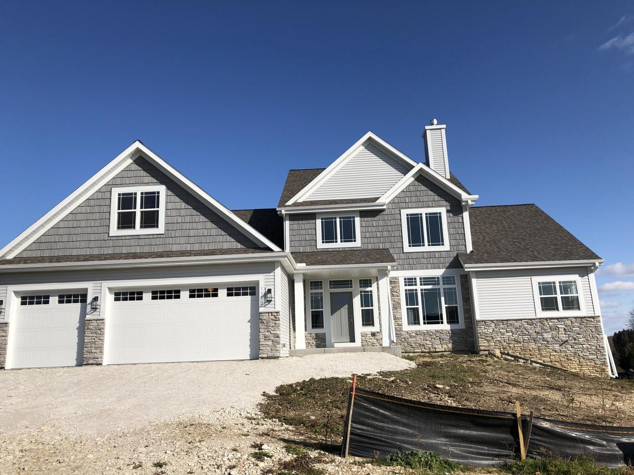 This lovely two story home is on a private cul de sac setting.  Full exposure lower level can add extra square footage to living space.  High end finishes are used throughout this open concept plan!  This home has everything you are looking for!  Seller offers one year home warranty!