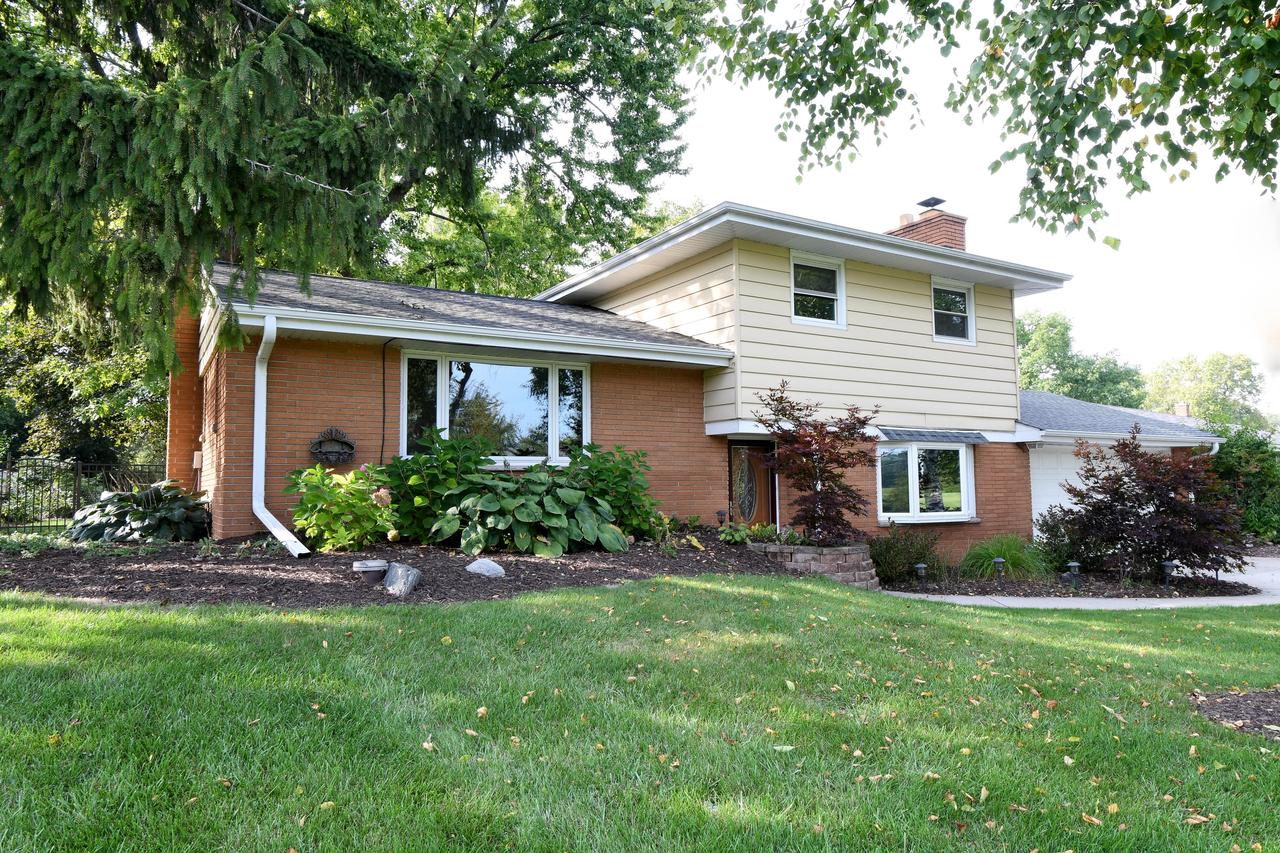 Welcome to a well maintained tri-level in the heart of Ozaukee County! Versatile home with newer kitchen, lannon stone fireplace, 3 cozy bedrooms, and updated master bathroom. The fenced in backyard boasts mature trees, a cascading waterfall and private patio. A nice home in a good neighborhood.