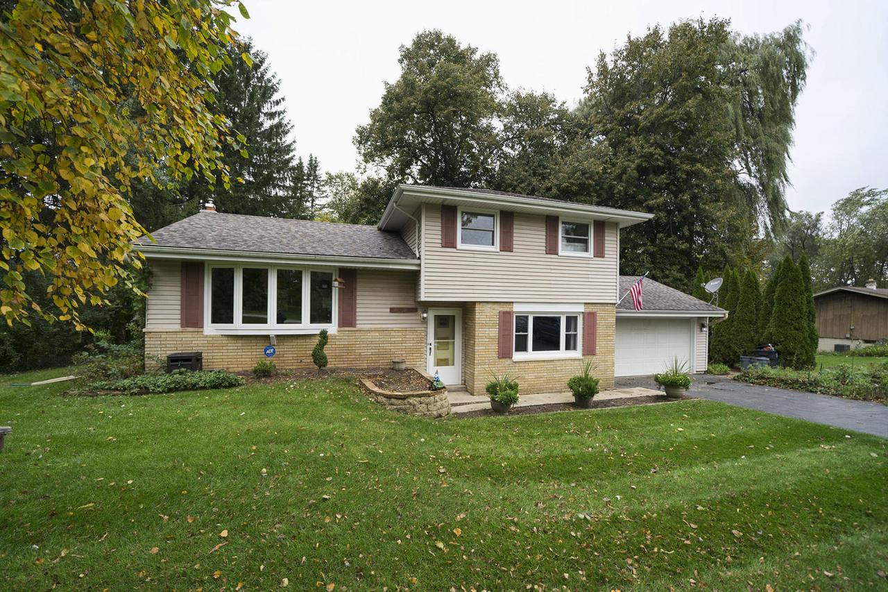 Location, updates, and a fabulous lot! Don't miss out on this terrific Menomonee Falls Tri-Level! Kitchen tastefully updated in 2019. All windows are newer (2017-2018). New roof (2017) The living room bay window is newer (2015)., and all on a gorgeous .51 acre lot. Features include a large wood deck and all appliances are included.