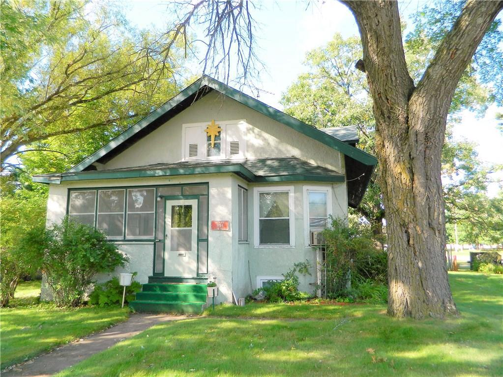 Nice, solid 4BR/1BA home on a corner lot in Lewis. Features lots of natural woodwork, large living room, kitchen & dining room, 2 main floor bedrooms, main floor full bathroom plus full basement.  Stucco exterior and 1-car detached garage for parking and storage.  Enjoy the enclosed front porch and relax on the big back entry deck and patio.  Great property - come see!