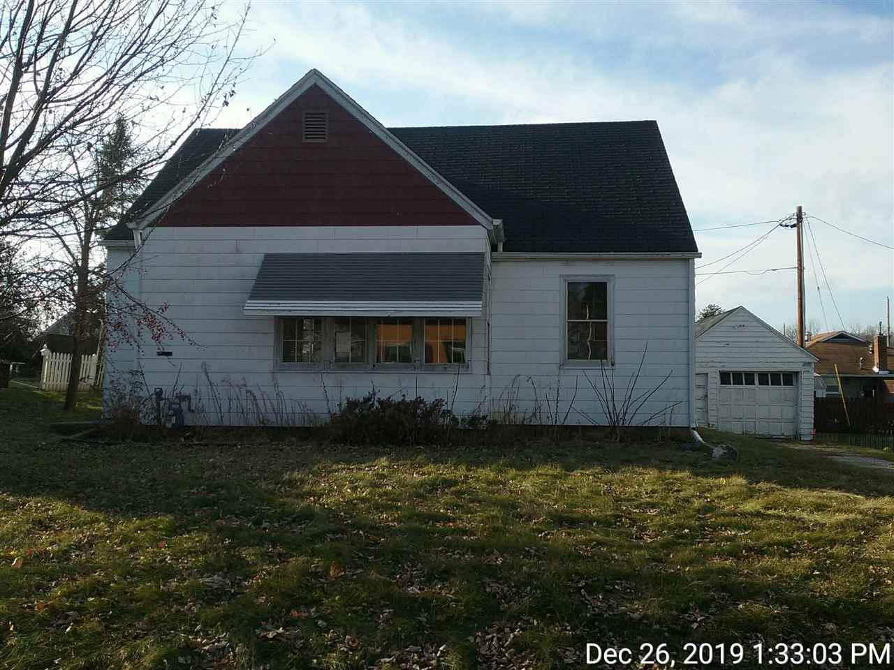 Cute two bedroom, one bath home.  Some wood floors, expandable attic for additional living space. Great location close to schools and downtown.  Property is winterized, furnace is not working and property cannot be dewinterized for inspections or appraisals.  Asphalt siding.