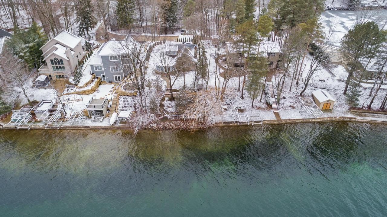Don't miss this opportunity to own 60 ft of prime frontage on Big Cedar Lake!  Well-positioned lake house with stunning view of the water. Nicely remodeled first floor and kitchen. Definitely a ''cooks delight'' for entertaining. Plenty of custom Knotty Alder cabinetry, striking granite countertops.  Gorgeous wood floor through the main level. Fresh paint interior and exterior. New roof in 2017 and new well in 2018.Professional landscaping reworked in 2019. Excellent swim frontage including 2 piers. Bring your family and spend some golden years living on Big Cedar Lake.