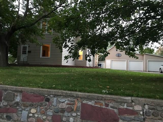 True Farmhouse! This solid 1919 4 BR home is one of the oldest houses in Barron. Beautiful original trim & built-in hutches throughout this spacious cozy home. Located in a quiet neighborhood within blocks of the schools & hospital. Relax on the 24x13 deck overlooking a large backyard with firepit; plenty of room for family activities. Escape to the fully insulated entertainment area above the 3-stall garage with ample workspace to complete all your projects.